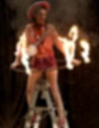 stunt hula hoop Lanigan Judith fire flaming ladder street theatre banjolele