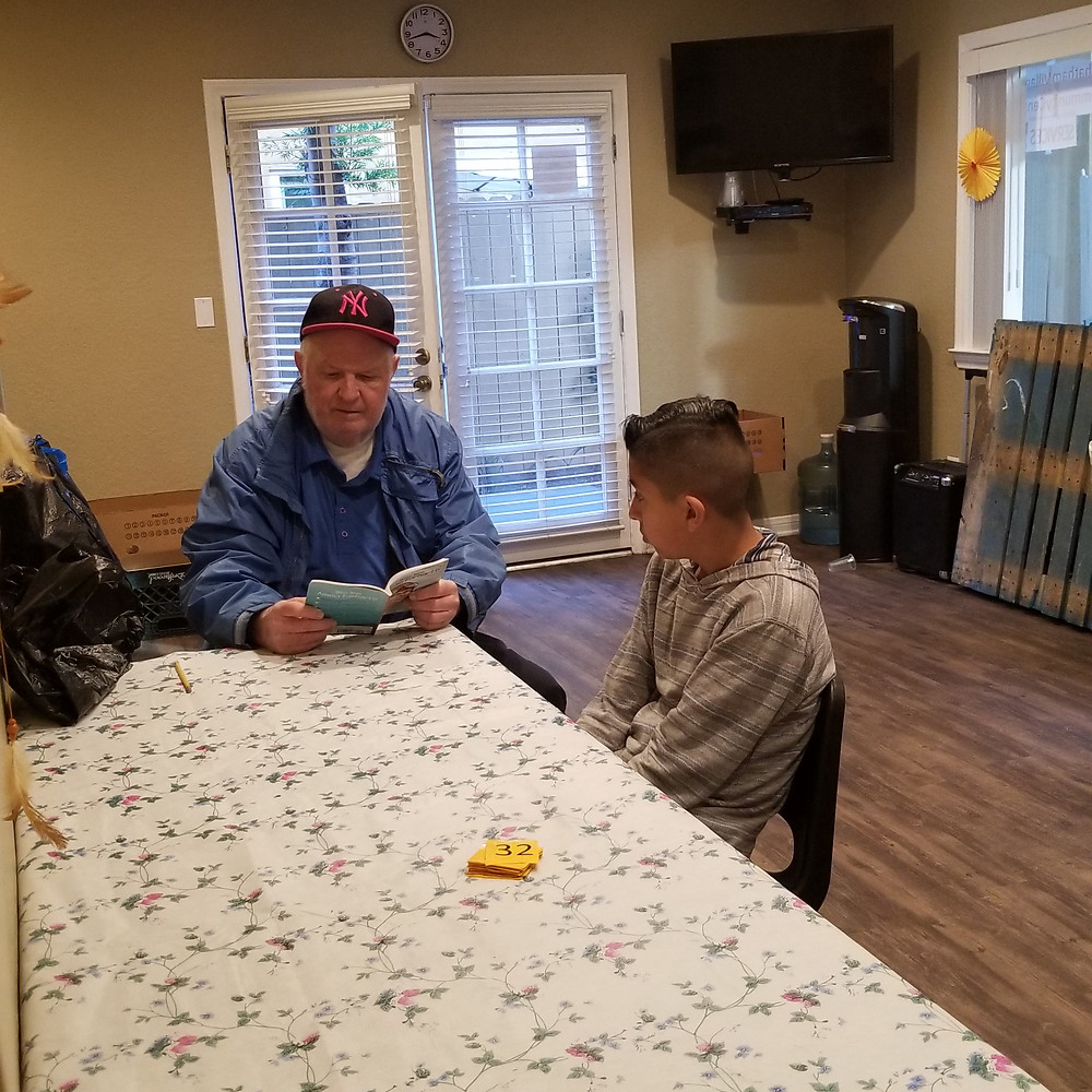 Steve Gastineau helping a resident at Chatham Village Apartments