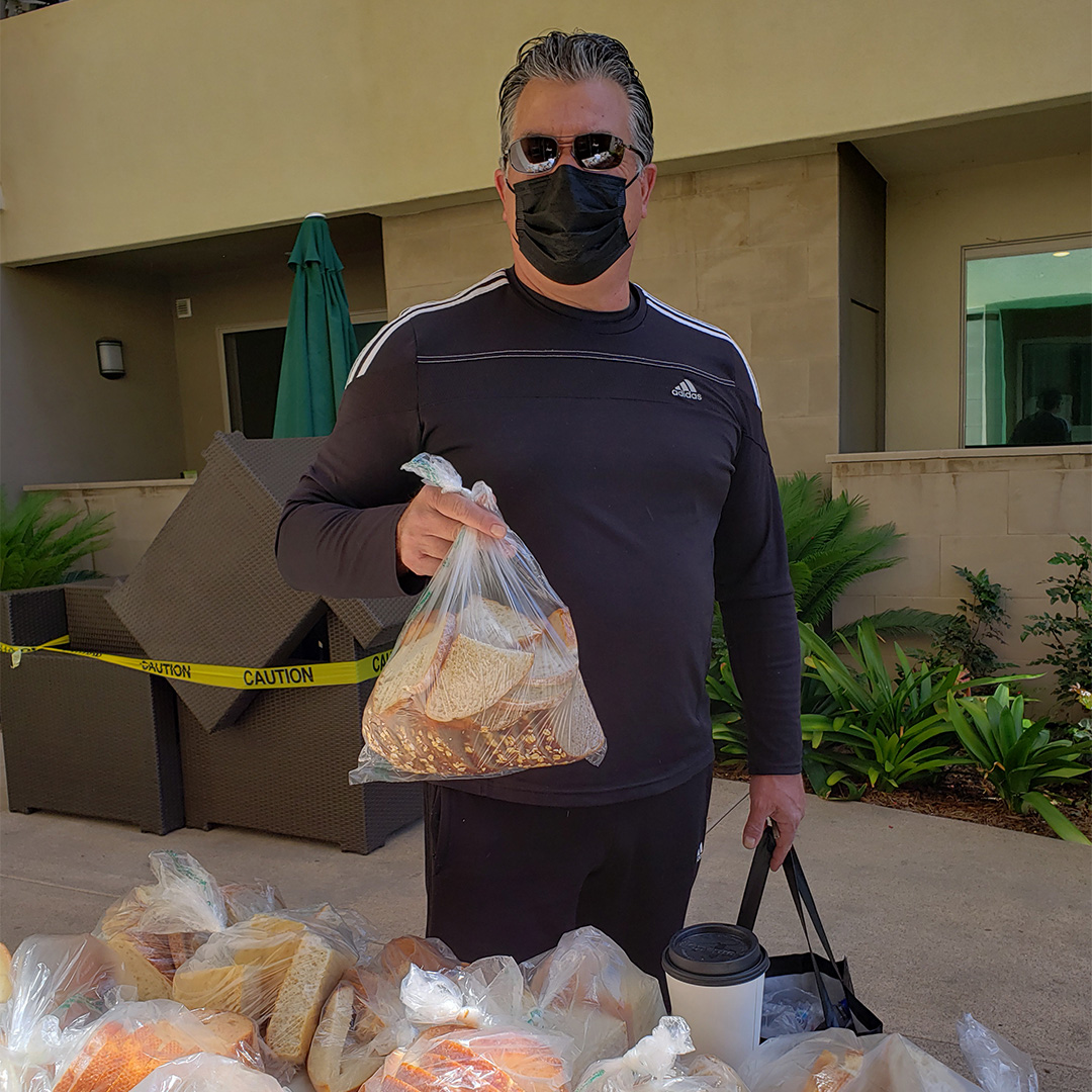 Resident Receiving Their Bread - Versa (