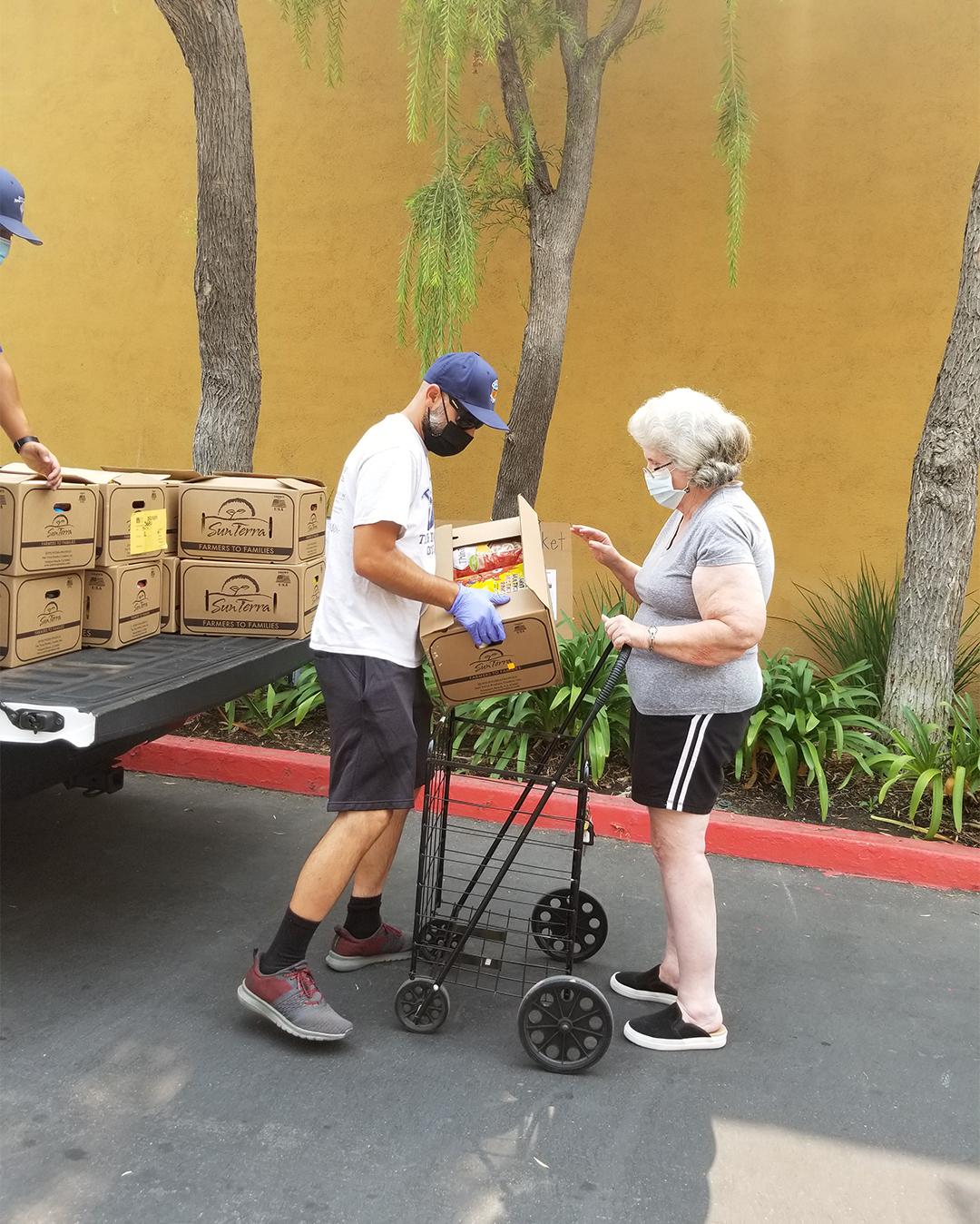 Resident Receiving Her Food Supplies