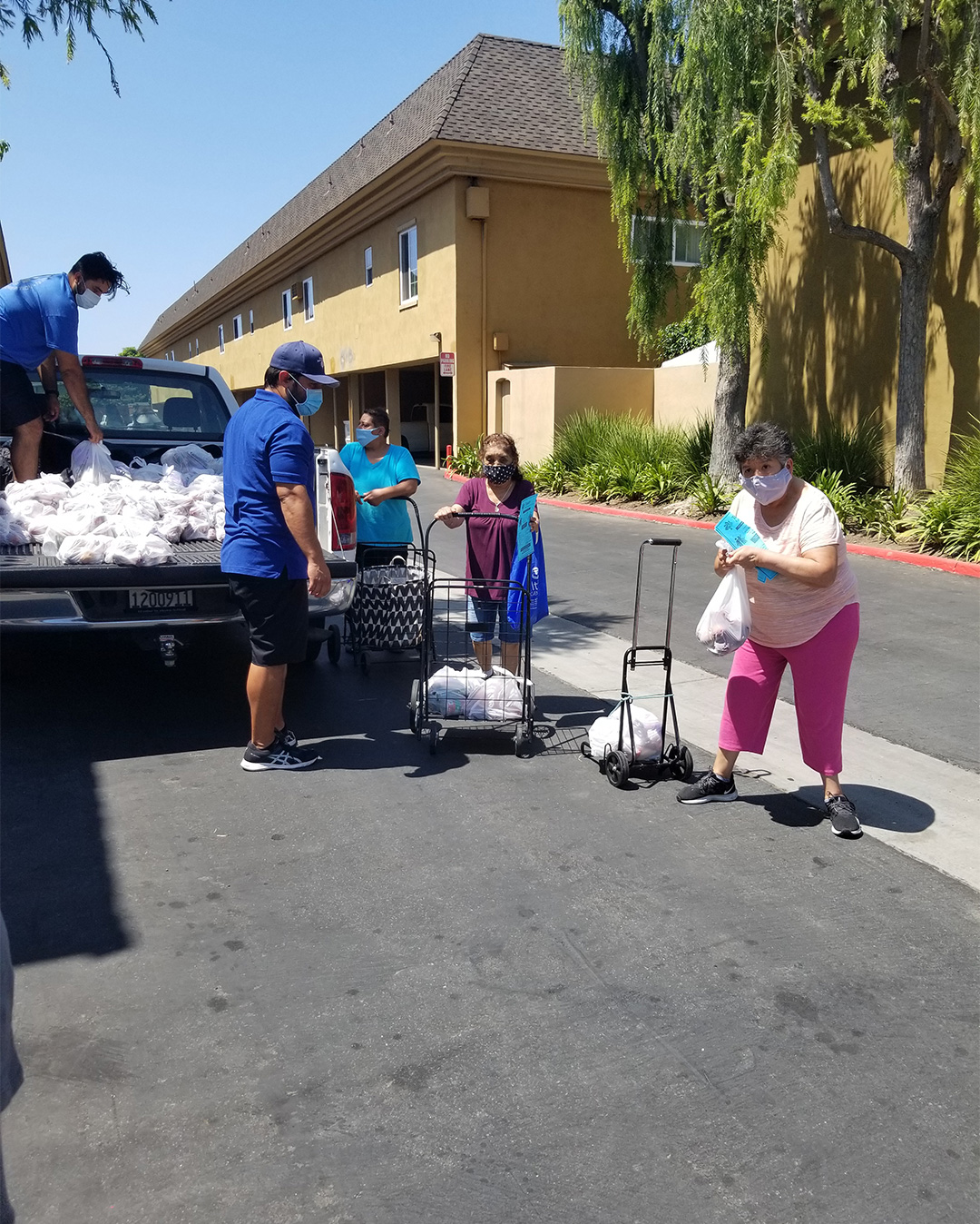 Residents Showing Their Food Bags