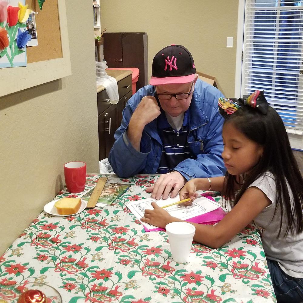 Steve Gastineau working with Genesis Pineda with homework