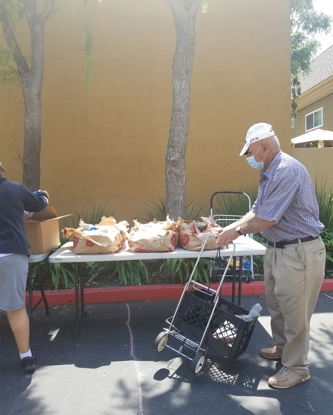 Resident Receiving His Food Supplies