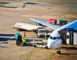 Air plane with cargo being loaded