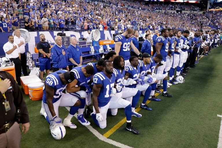 Indianapolis Colts players knelt during the national anthem before their game against the Cleveland Browns on Sunday. Credit Darron Cummings/Associated Press