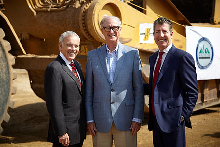 Picture of Ed Roski, Mayor Steve Hogan, and Randall Hertel in front of a tractor
