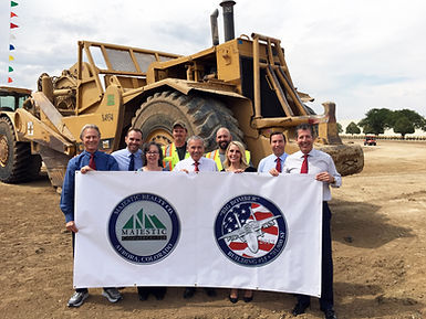 Majestic Commerce Center team photo in front of tractor