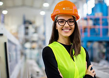 Girl with hard hat in warehouse