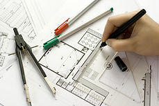 Architect designing on paper