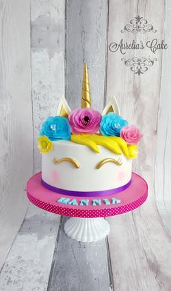 Unicorn cake with flowers.