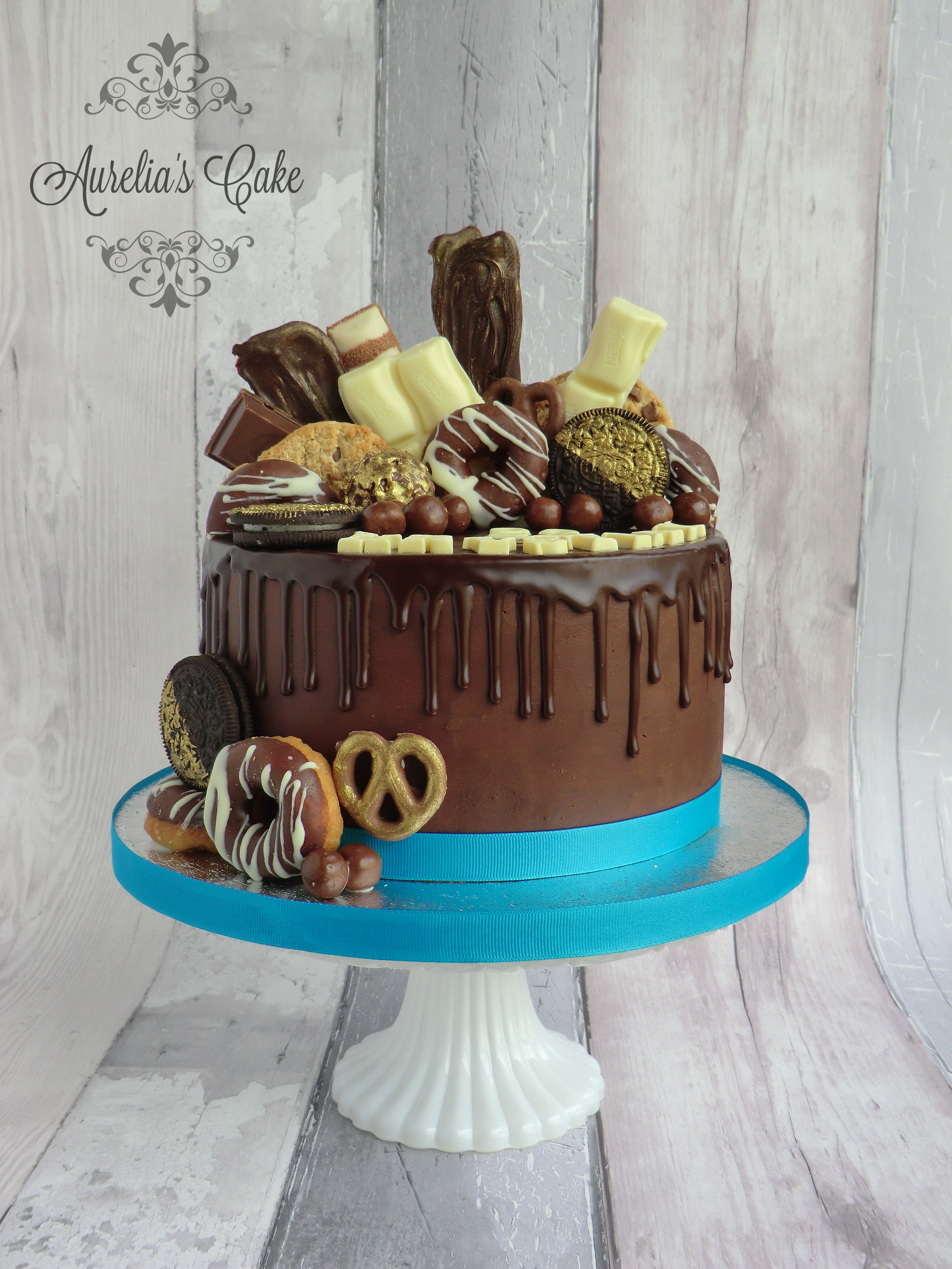 Chocolate drip cake with sweets.