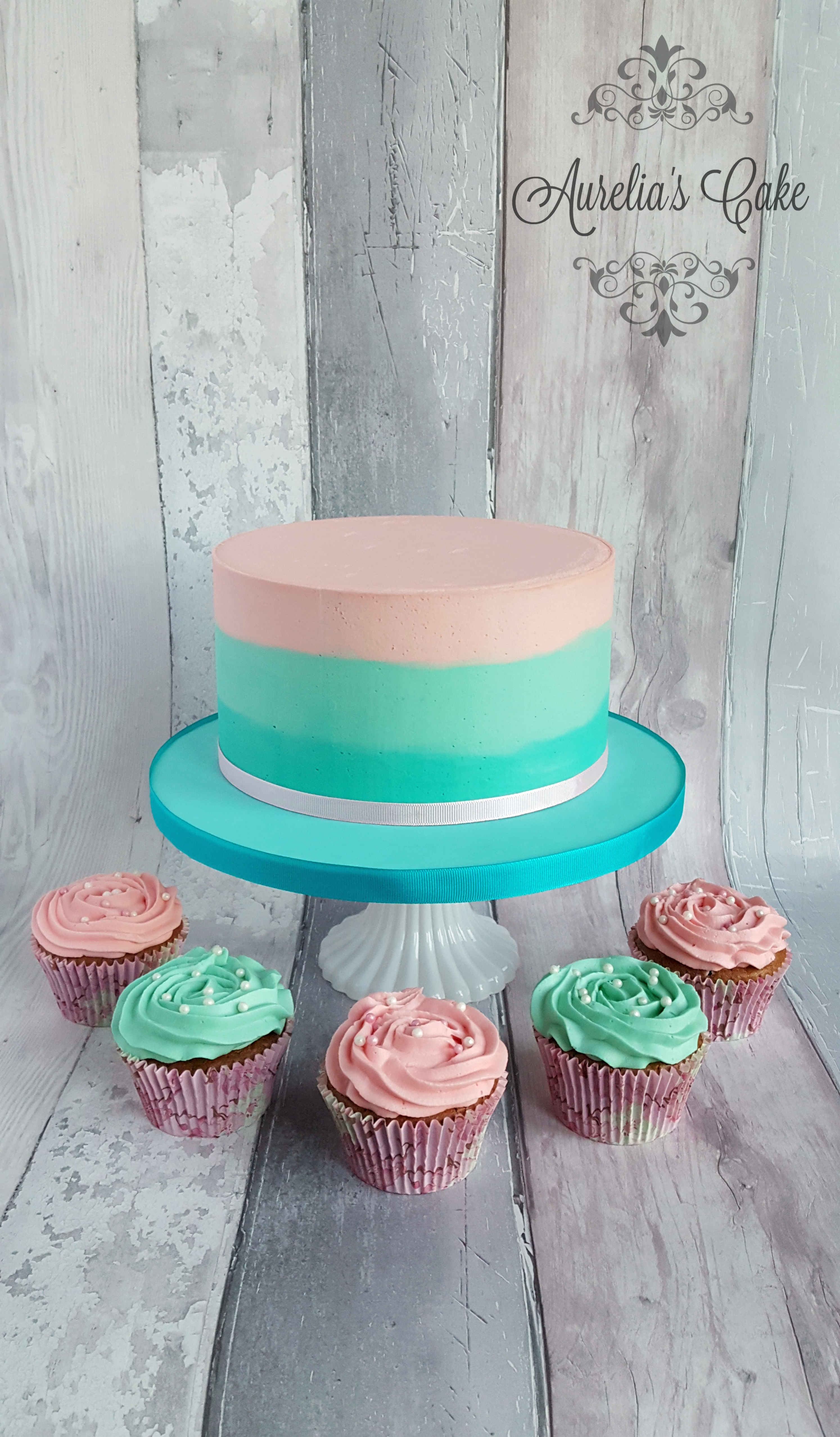 Pastel colous cake and cupcakes