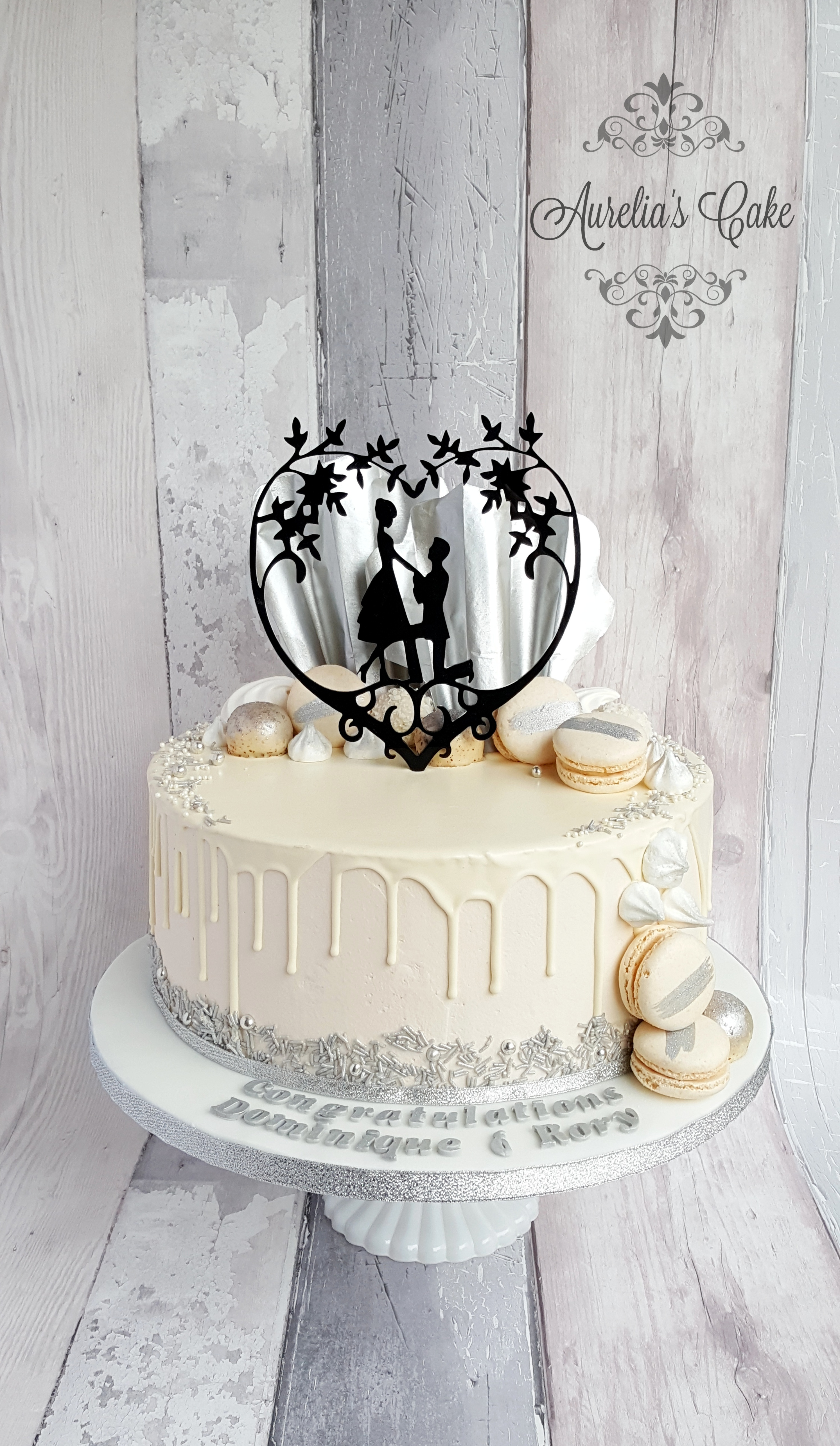 White and silver drip engagement cake