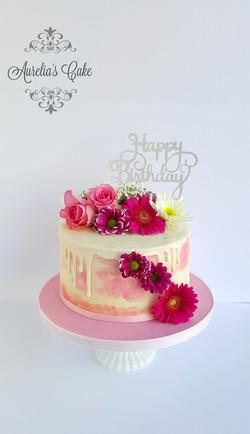Drip cake with fresh flowers