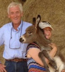 Joe Mann, volunteer and baby donkey at Big Oaks Rescue Farm