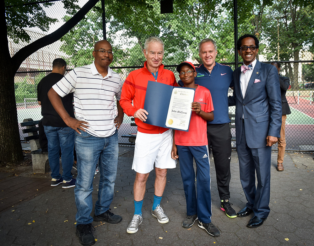 Khallid Bey (Harlem resident and father of ten-year-old 2017 John McEnroe Tennis Academy scholarship winner Joshua Bey), John McEnroe, Joshua Bey, Patrick McEnroe and Harlem NY State Assembly Member Al Taylor at JMTA 2018 scholarship tryouts