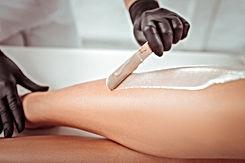 Applying warm wax. Resolute salon worker