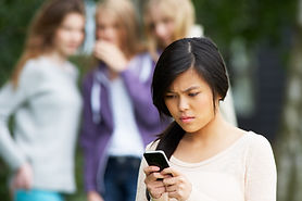 Teenage Girl Being Bullied By Text Messa