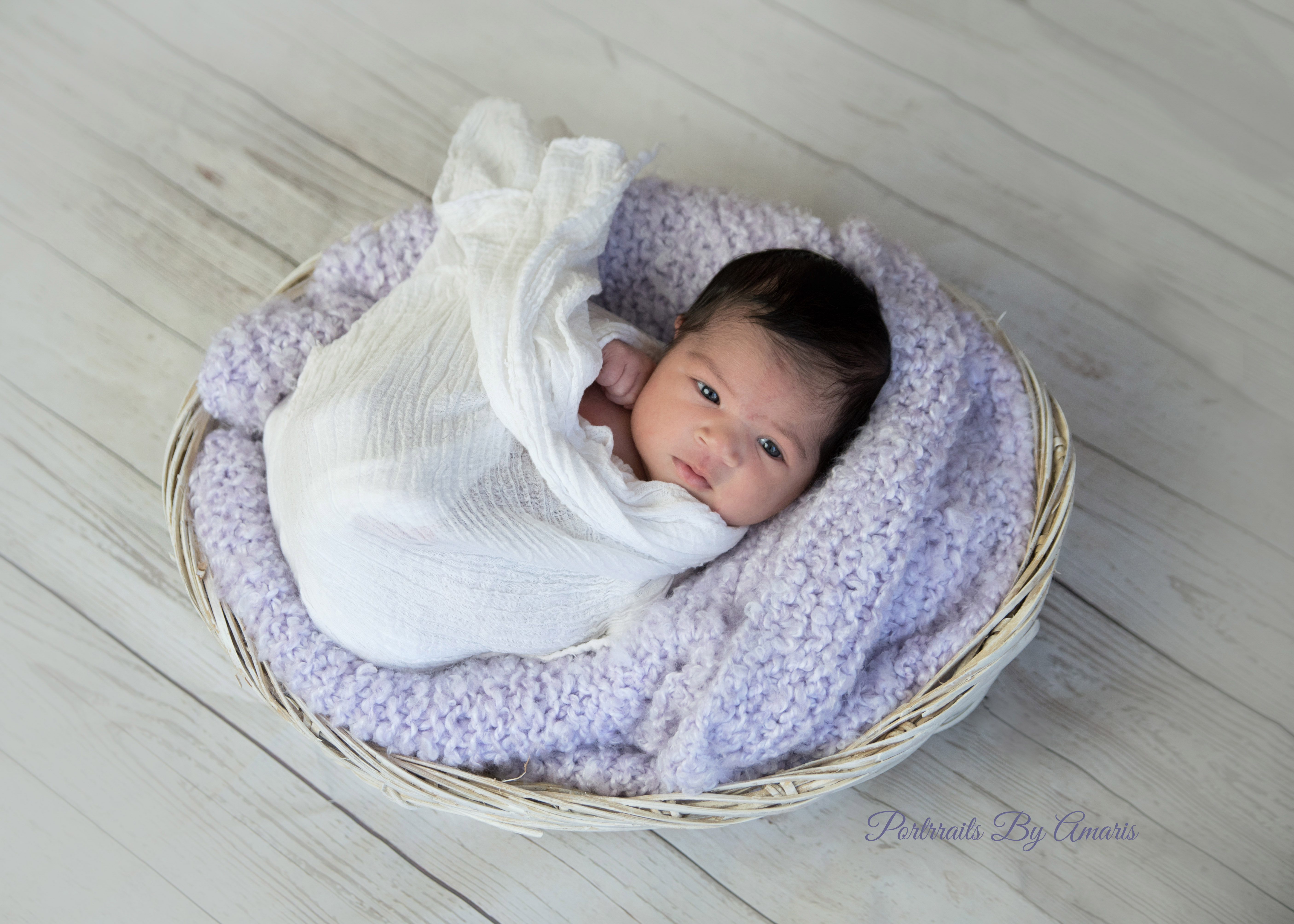newborn-basket-purple-blanket