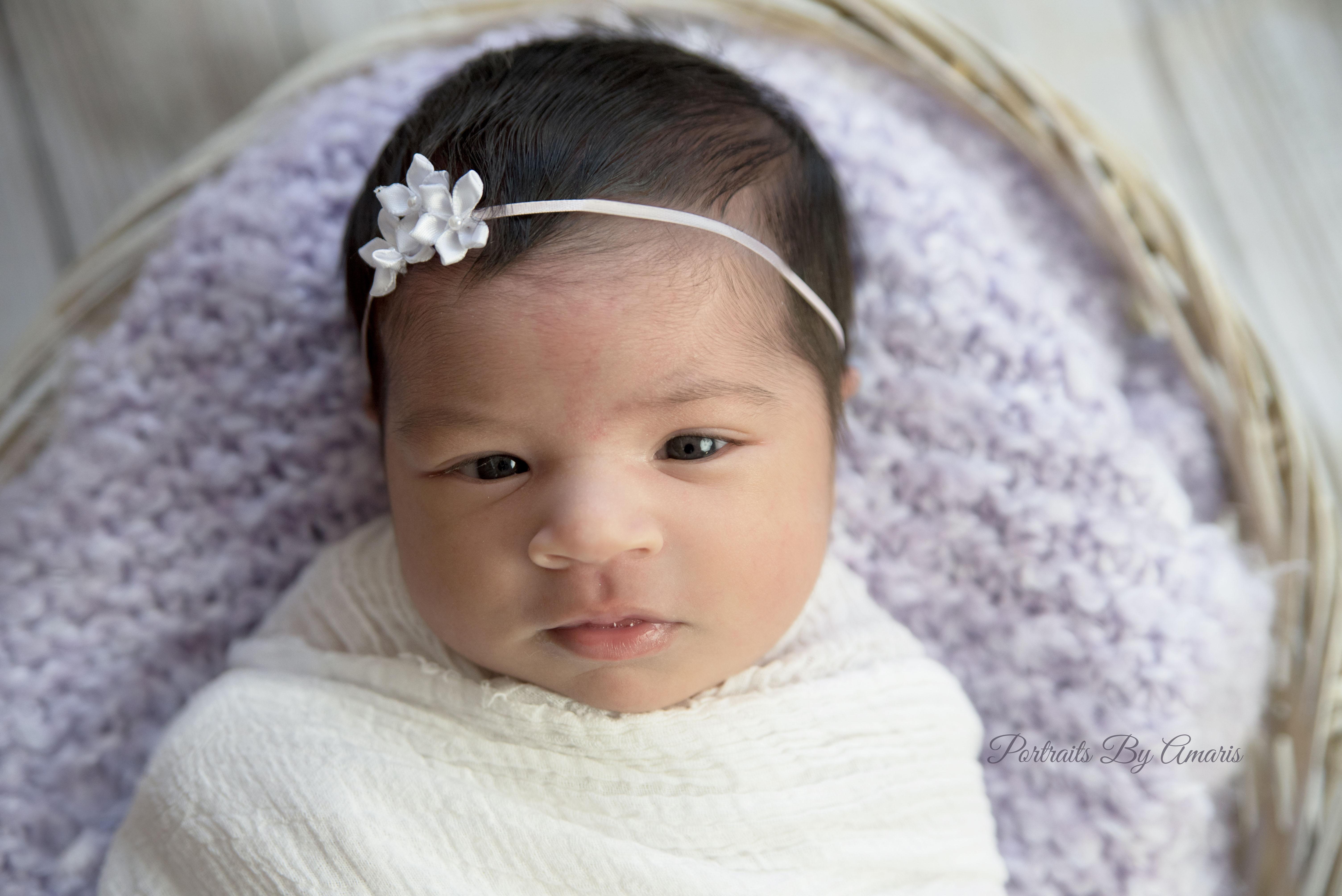 newborn-girl-purple-and-white-blanket