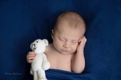 Newborn Boy with White Teddy Bear