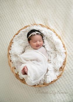 Newborn-girl-in-basket