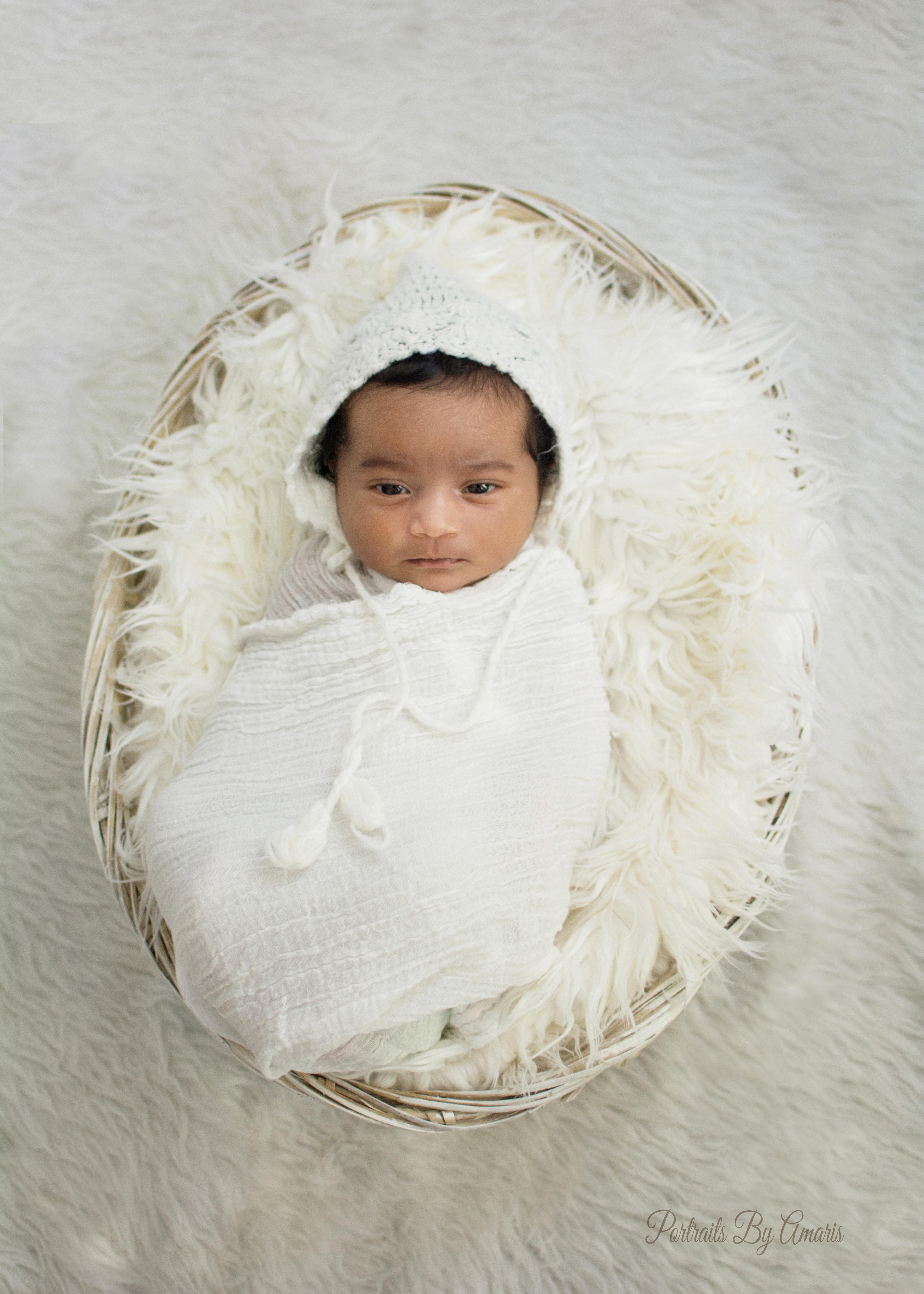 Newborn with layers of white fabrics