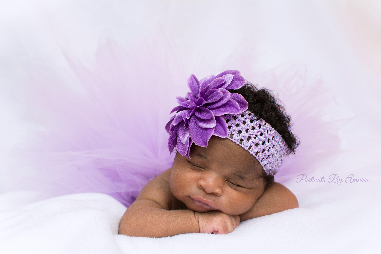Newborn girl in purple tutu