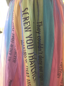 Secton of the skirt from the drag costume with various quotes from the film Pride