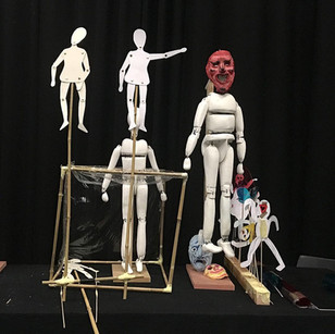 A mix of puppets from the show - bunraku and shadow puppets.