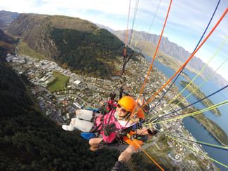 Paragliding Over The Pristine Waters Of Queensland