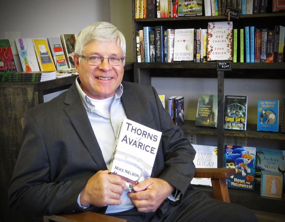 Author Mike Nelson shows off his first full-length novel, Thorns of Avarice.