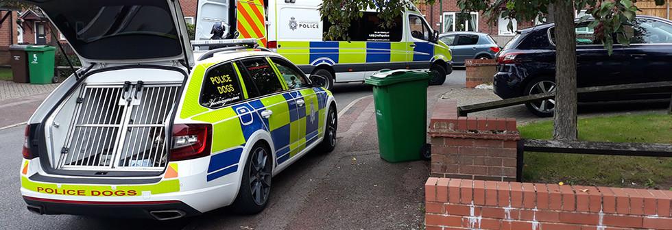 Police dog patrol van parked.jpg