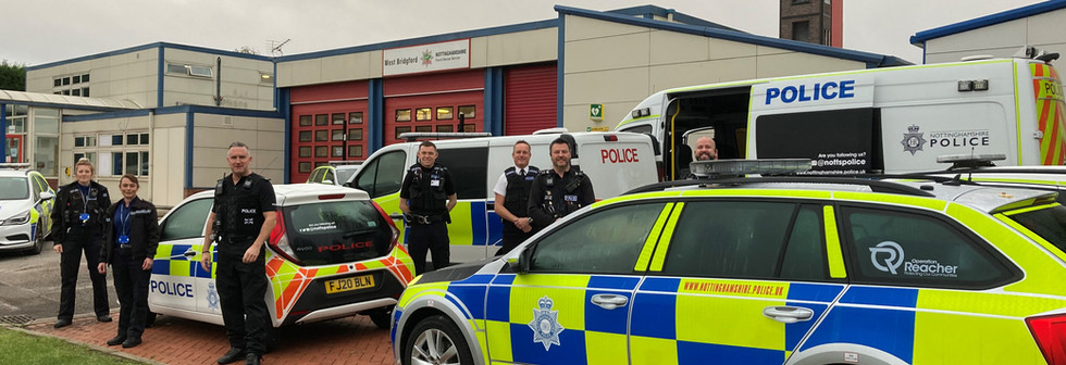 Officers with operational cars and vans.