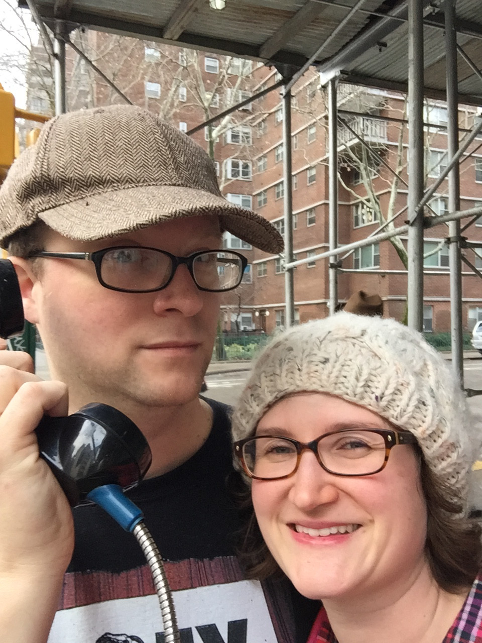 A couple use a payphone in New York City.