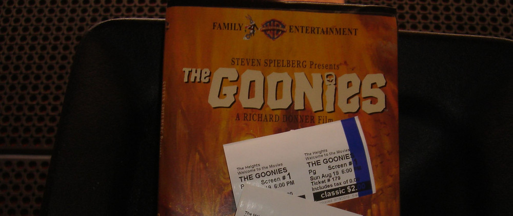 The Goonies VHS tape with movie ticket stubs.