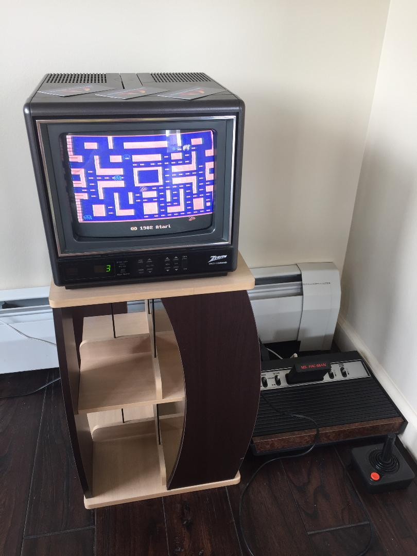 Atari 2600 connected to a Zenith Space Command CRT TV.