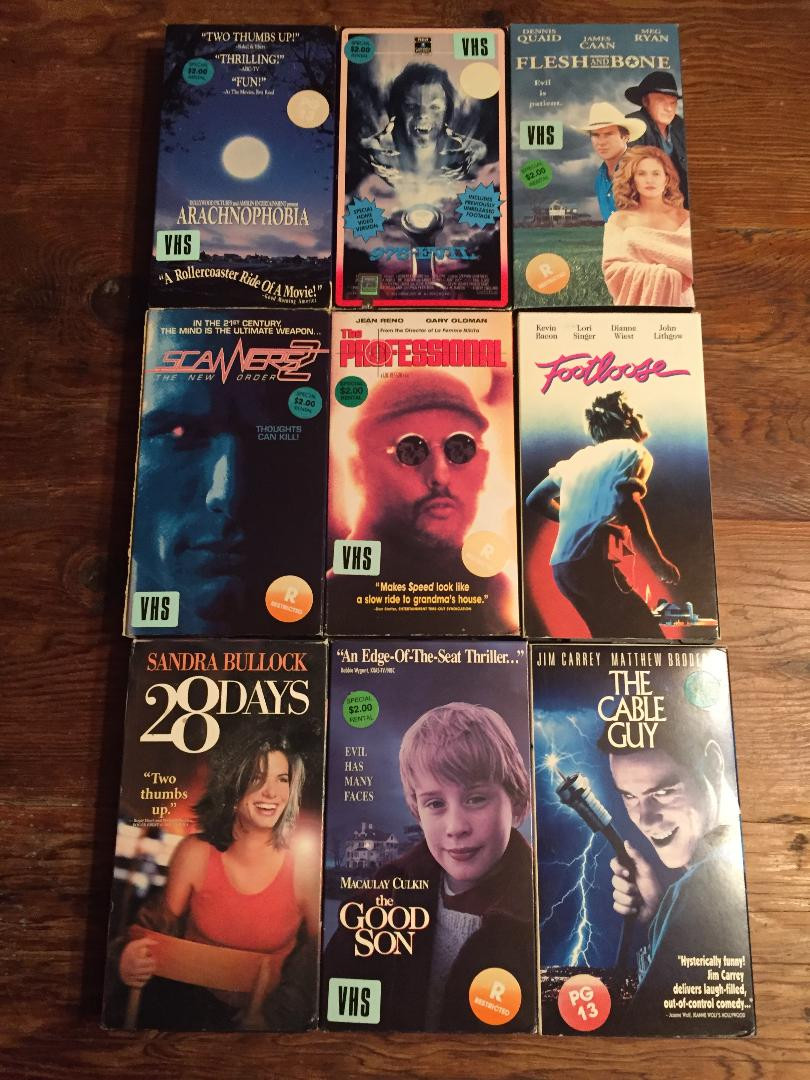 VHS tapes: Arachnophobia, The Good Son, The Professional, The Cable Guy, 28 Days, Footloose, Flesh and Bone, Scanners 2, 976-EVIL