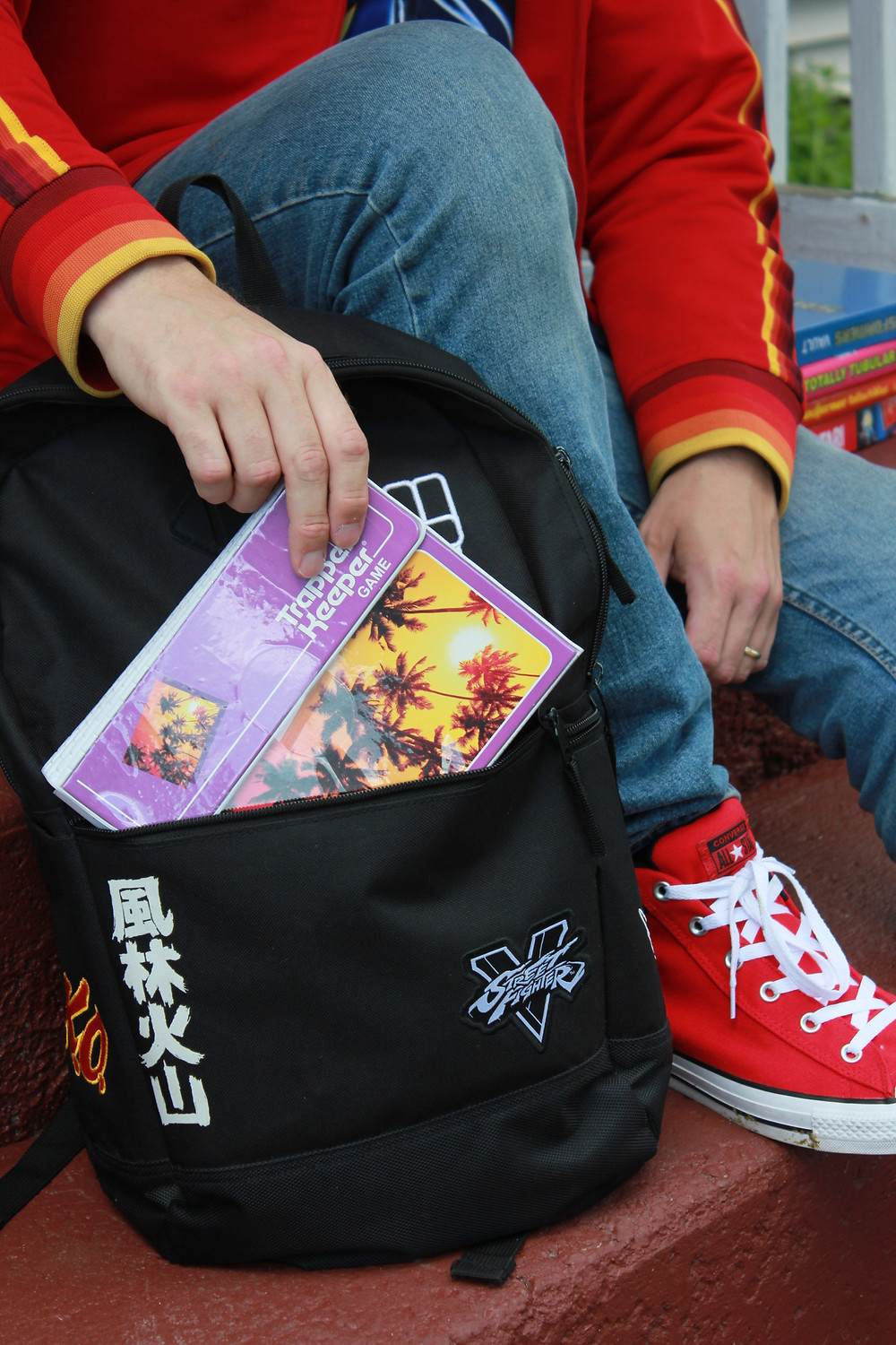 The Trapper Keeper Game from Big G Creative in a Street Fighter V backpack.