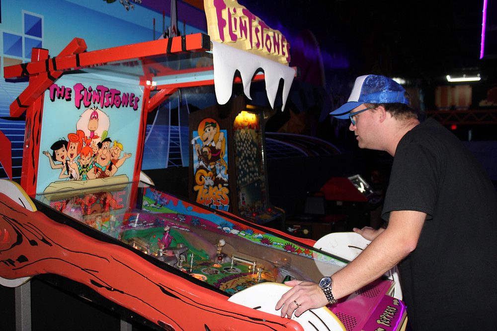 Retroinjection.com blogger Dave Fife plays The Flintstones ICE pinball at The Game Preserve NASA arcade
