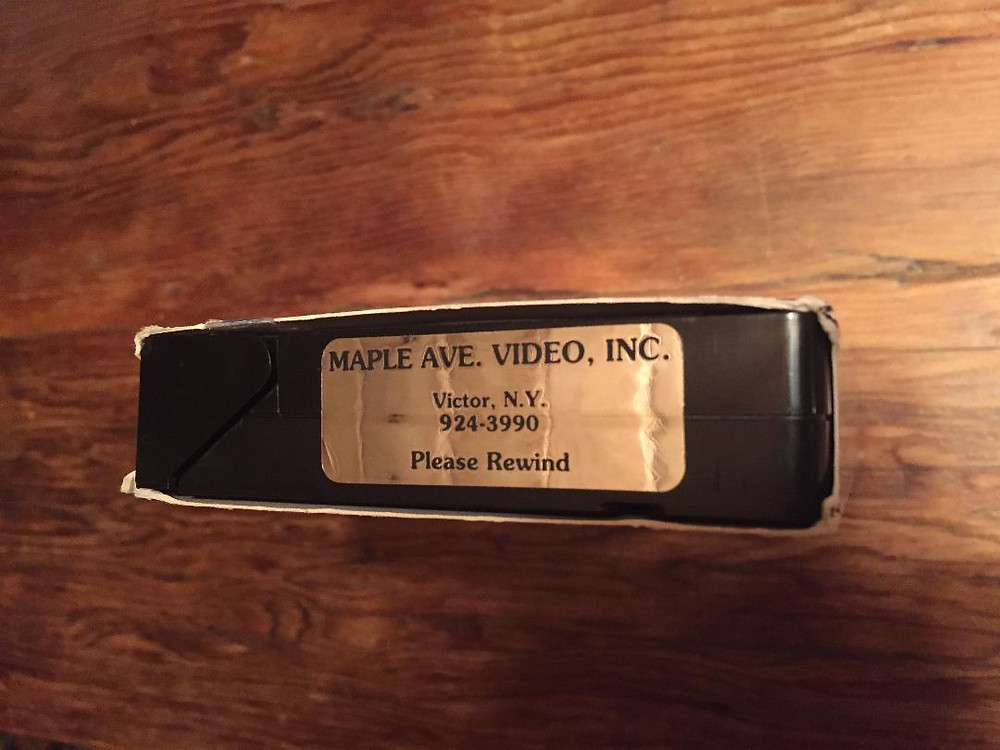 VHS rental sticker.