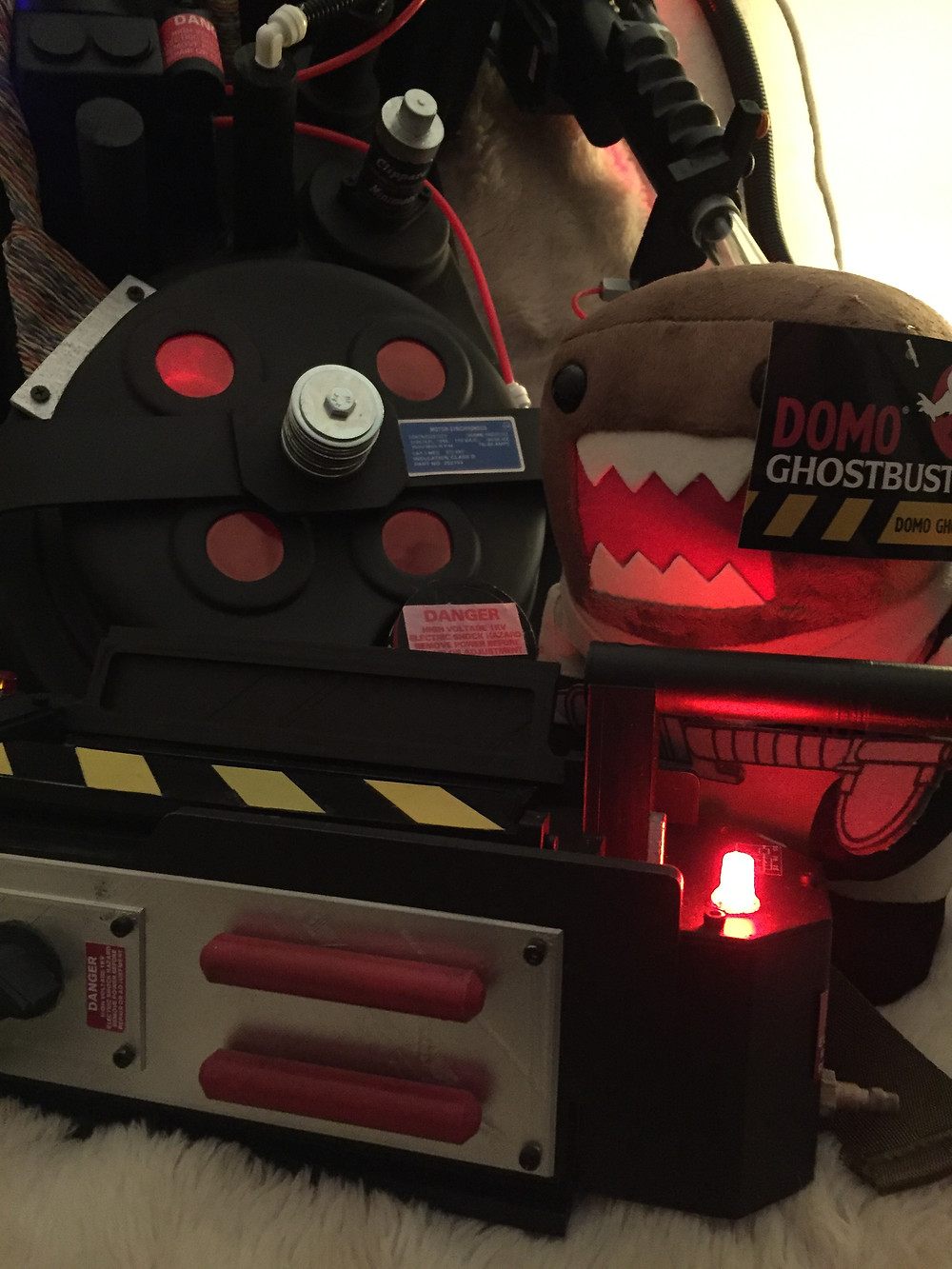 Ghostbusters Domo plushie toy with ghost trap and proton pack.