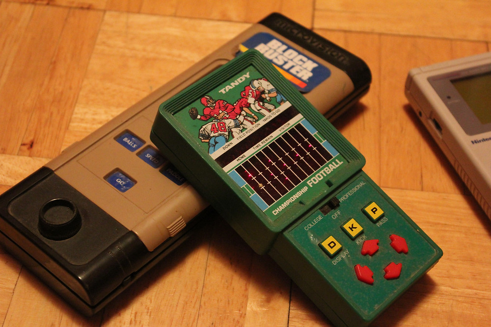 Milton-Bradley Microvision with Tandy LED Championship Football game and Nintendo Game Boy.