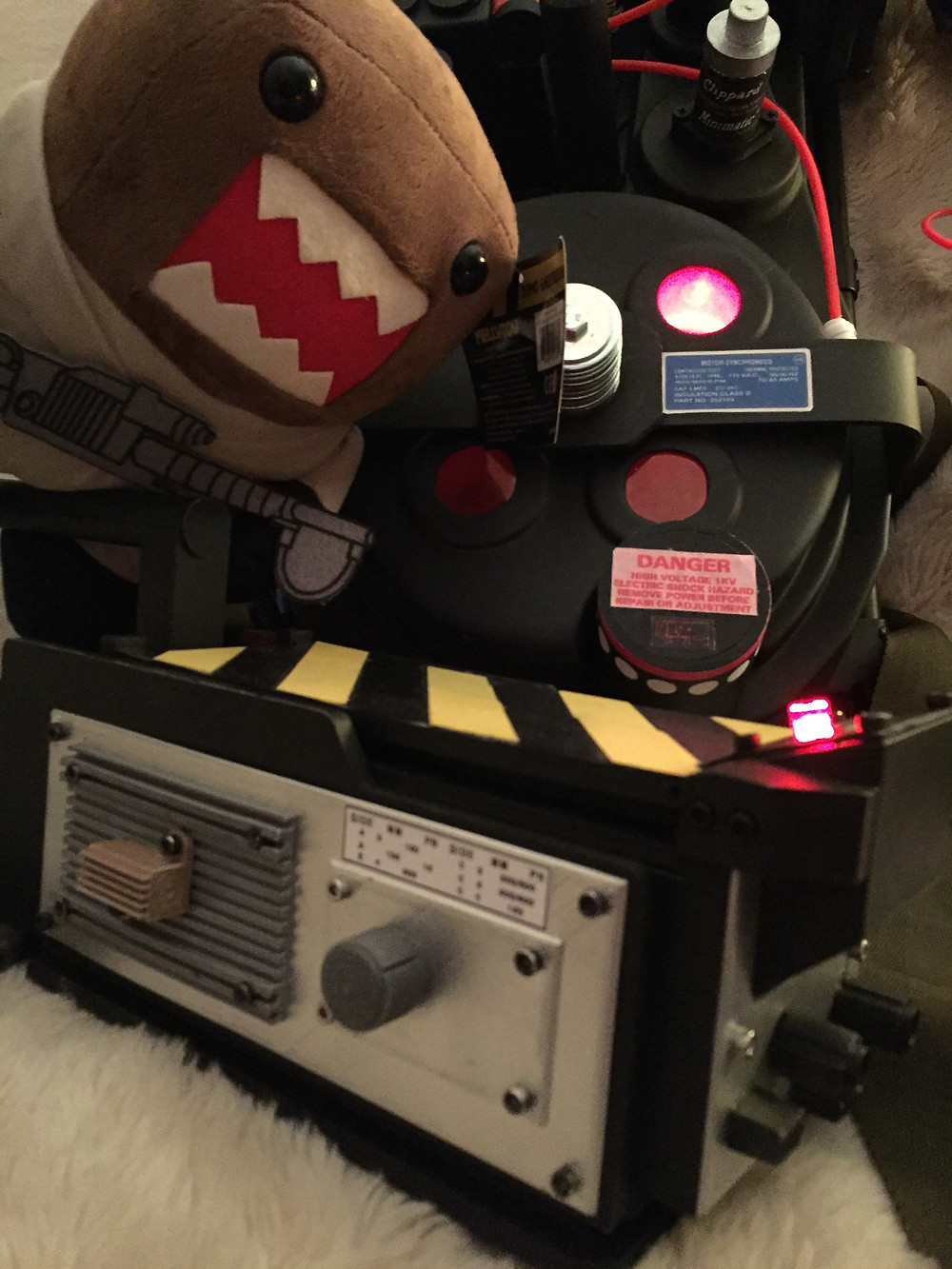Ghostbusters proton pack and ghost trap with Ghostbuster Domo plush.