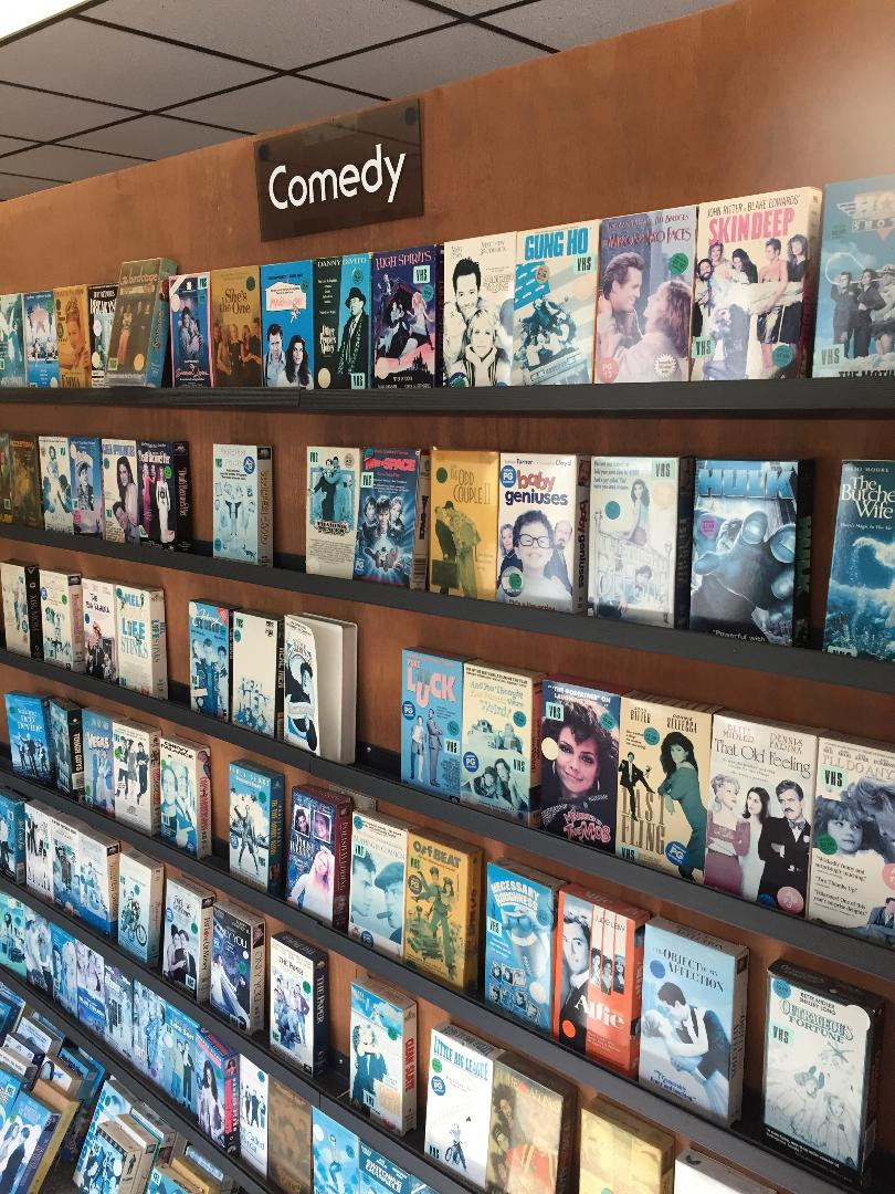 Comedy VHS tapes in a video rental store.