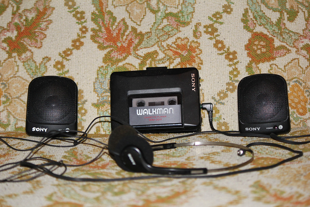 Sony Walkman WM-2011 with speakers and headphones.