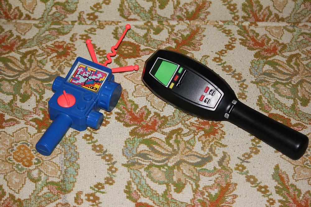 Kenner and Spirit Halloween Ghostbusters PKE meters.