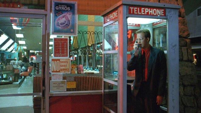 Harry answers the payphone outside of Johnie's Coffee Shop in Steve De Jarnatt's apocolyptic film Miracle Mile.