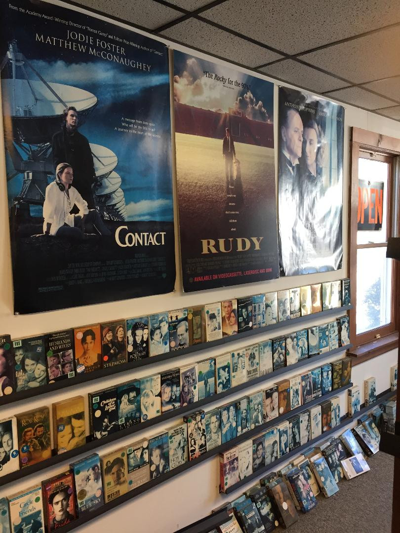 VHS movies for rent in a video store.