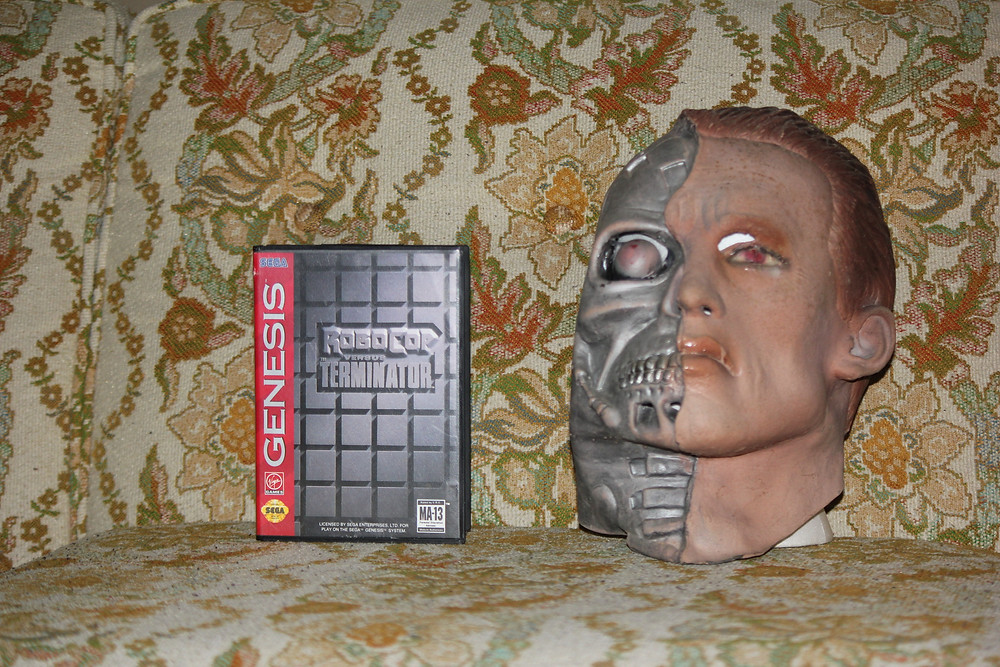 Robocop Vs. The Terminator Genesis game with Terminator Halloween mask.